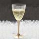 Vīna vai šampanieša glāze ar zeltu kājiņu, 140 ml.. Plastikāta, caurspīdīga 140 ml. .